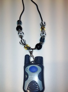 medical alert button with Pandora-style jewelry necklace