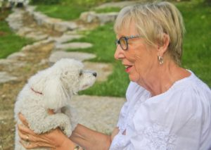 pet dog with senior elderly woman